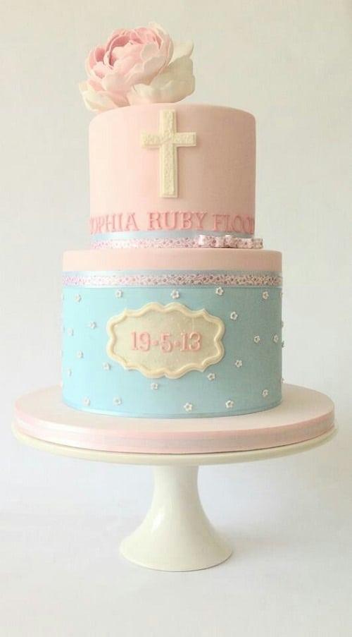 Gâteau de baptême fondant bleu et rose